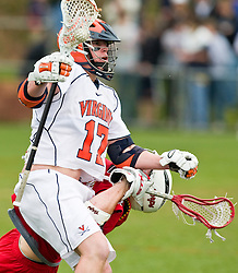 Virginia Cavaliers M  Shamel Bratton  (1) takes out a UMD defender and keeps possesion.  The #9 ranked Maryland Terrapins fell to the #1 ranked Virginia Cavaliers 10 in 7 overtimes in Men's NCAA Lacrosse at Klockner Stadium on the Grounds of the University of Virginia in Charlottesville, VA on March 28, 2009.