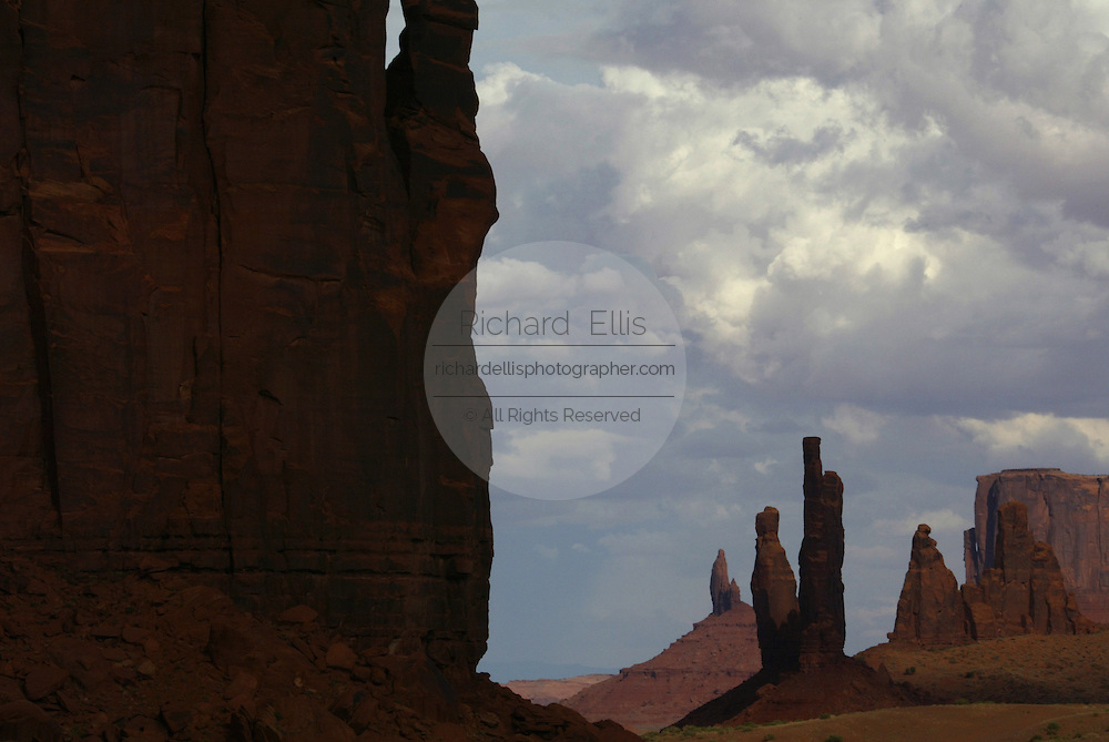 View of the totem pole in Monument Valley on the southern border of Utah with northern Arizona. The valley lies within the range of the Navajo Nation Reservation. The Navajo name for the valley is Tsé Bii' Ndzisgaii - Valley of the Rocks.