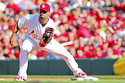 17 April 2010:St. Louis Cardinals first baseman Albert Pujols (5) catches a ball for an out against the New York Mets at Busch Stadium in St. Louis, Missouri. The Game would go 20 innings, with the Mets winning 2-1.