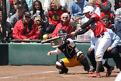 26 April 2015:   Batting for the Redbirds is Regan Romshek catching for the Ramblers is Annie Korth during an NCAA Missouri Valley Conference (MVC) Championship series women's softball game between the Loyola Ramblers and the Illinois State Redbirds on Marian Kneer Field in Normal IL