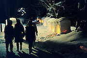Japanese people admiring the snow lanterns at the Hirosaki snow festivalin -5degC conditions.