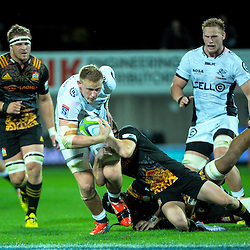 Daniel Du Preez is tackled during the Super Rugby match between the Chiefs and Lions at Yarrow Stadium, New Plymouth, New Zealand on Saturday, 5 March 2016. Photo: Dave Lintott / lintottphoto.co.nz