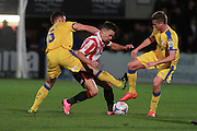 Luke George and Billy Waters during the Vanarama National League match between Cheltenham Town and Chester City at Whaddon Road, Cheltenham, England on 5 December 2015. Photo by Antony Thompson.