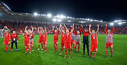 SOUTHAMPTON, ENGLAND - Friday, April 6, 2018: Wales' Natasha Harding (#7) and Jessica Fishlock (#10) celebrate with their team-mates celebrate after a hard fought goal-less draw against England during the FIFA Women's World Cup 2019 Qualifying Round Group 1 match between England and Wales at St. Mary's Stadium. (Pic by David Rawcliffe/Propaganda)