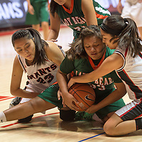 010214      Cayla Nimmo<br /> <br /> Wingate Bear Ariel Brown (33) struggles for possession of the ball with Grants Pirates Nychelle Shutiva (23) and FFelisha Patricio (1) in the tournament game held in Albuquerque Friday afternoon.