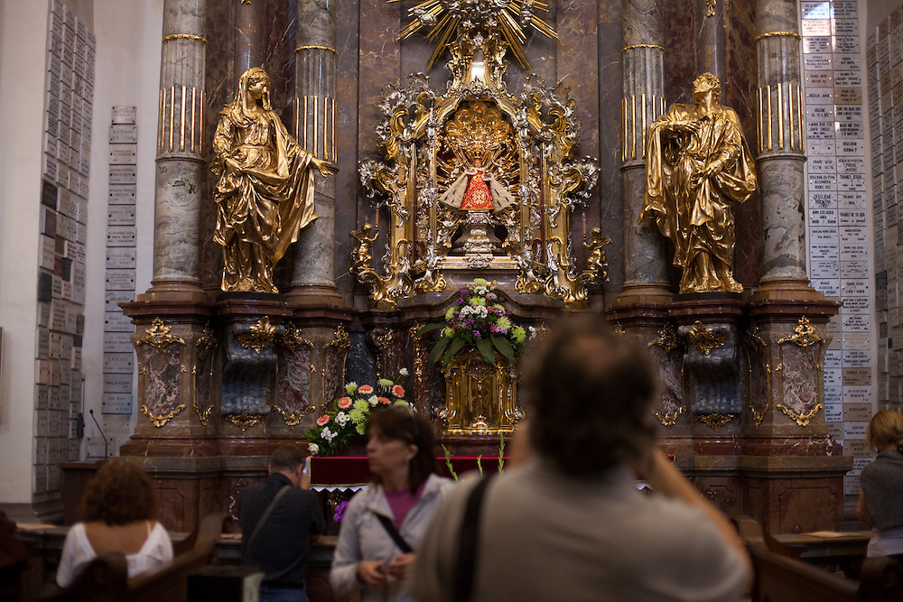Visitors at the church of St. Maria Victorious (Church of Our Lady Victorious – Prague Infant Jesus) located at the Lesser Town (Mala Strana) in Prague.