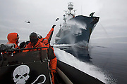 Sea Shepherd crew lob bottles of butyric acid at Japanese harpoon ship, the Yushin Maru No. 1, on Monday, Feb. 2, 2009 during a clash in Antarctica's Ross Sea.  'Rotten butter bombs' were aimed at the whaling ship's deck in the hope of making work onboard difficult and tainting whale meat to be sold at market.  Sea Shepherd claims to be non-violent, but its aggressive tactics have provoked criticism from other groups, making them the black sheep of the conservation movement. (Photo by Adam Lau)