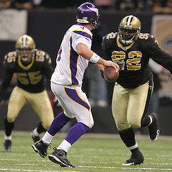 Jan 24, 2010; New Orleans, LA, USA; Minnesota Vikings quarterback Brett Favre (4) is pressured by New Orleans Saints defensive tackle Remi Ayodele (92) during the second half of the 2010 NFC Championship game at the Louisiana Superdome. Mandatory Credit: Derick E. Hingle-US PRESSWIRE