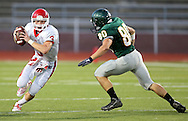 Washington's Reid Snitker (3) tries to avoid Kennedy's Nicholas Swartz (from left) during their game at Kinston Stadium in Cedar Rapids on Friday, August 30, 2013.