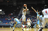 "Ole Miss forward Sebastian Saiz (11) scores against Southern at the C.M. ""Tad"" Smith Coliseum in Oxford, Miss. on Thursday, November 20, 2014. (AP Photo/Oxford Eagle, Bruce Newman)"