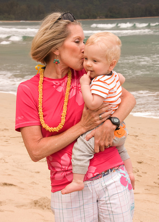 Kisses on the beach in Kauai, Hawaii.