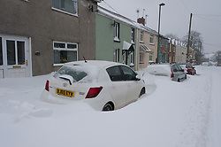 © Licensed to London News Pictures. 2/03/2018. Brynmawr, Blaenau Gwent,, South Wales, UK. Near gale force winds continue to worsen conditions by forming large snowdrifts. People battlle against the blizzard, snowdrifts and horrendous weather conditions as Storm Emma continues without mercy at Brynmawr in South Wales (the highest town in Wales.)  Photo credit: Graham M. Lawrence/LNP