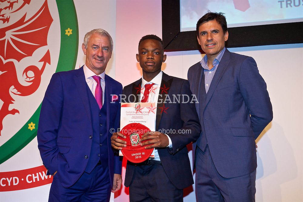 NEWPORT, WALES - Saturday, May 21, 2016: Rabbi Matondo is presented with his Under-16's cap by Wales' Elite Performance Director Ian Rush and National Team Manager Chris Coleman at the Celtic Manor Resort. (Pic by David Rawcliffe/Propaganda)
