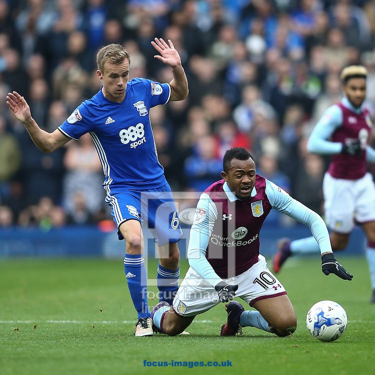 Jordan Ayew of Aston Villa (right)  goes down after contact with Maikel Kieftenbeld of Birmingham City (left) during the Sky Bet Championship match at St Andrews, Birmingham<br /> Picture by Andy Kearns/Focus Images Ltd 0781 864 4264<br /> 30/10/2016