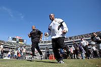 02 October 2011: Head coach Hue Jackson of the Oakland Raiders runs off the field after player warmups before the New England Patriots 31-19 victory against the Raiders in an NFL football game at O.co Stadium in Oakland, CA.