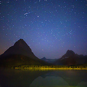 Shooting star seen from the Many Glacier Hotel on Swiftcurrent Lake in Glacier National Park, Montana.