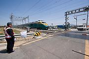 Railway crossing near Hamyeol. A Saemaeul Train going from Seoul to Kwangju.