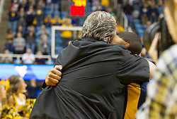Nov 23, 2015; Morgantown, WV, USA; West Virginia Mountaineers guard Jaysean Paige (5) sheds a tear while he hugs West Virginia Mountaineers head coach Bob Huggins during senior night ceremonies before their game against the Texas Tech Red Raiders at WVU Coliseum. Mandatory Credit: Ben Queen-USA TODAY Sports
