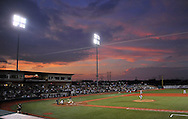A colorful sunset made a perfect backdrop to the Lake Erie Crushers final game of the season last night against River City. DAVID RICHARD / CHRONICLE