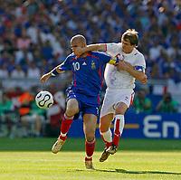 Photo: Glyn Thomas.<br />France v Switzerland. Group G, FIFA World Cup 2006. 13/06/2006.<br /> France's Zinedine Zidane (L) is silenced by Switzerland's Johann Vogel.