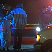 Family members embrace each other at the scene of a shooting on Veterans Boulevard in Brundidge, Ala., early Saturday, Dec. 27, 2014. One person was killed at the scene, and others were transported to a local hospital. (Photo/Thomas Graning)