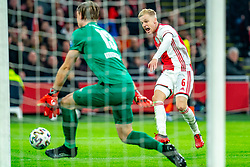 Donny van de Beek #6 of Ajax and Lars Unnerstall #13 of PSV Eindhoven in action during the match between Ajax and PSV at Johan Cruyff Arena on February 02, 2020 in Amsterdam, Netherlands