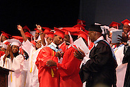 Valedictorian Gabriel Brown (front left in red) gets a standing ovation following his remarks to the class of 2010 during the Trotwood-Madison High School Commencement at the Victoria Theatre in downtown Dayton, Tuesday, June 1, 2010.