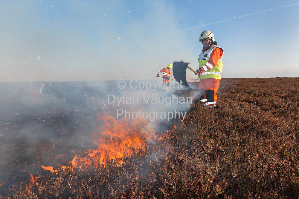6/4/13.Firefighters pictured trying to control gorse fires on Brandon Hill near Graignamanagh County Kilkenny over the weekend. .Widespread fires were spread across the Blackstairs mountain range and Mount Leinster over the weekend...Pictured are fire fighters from Graignamanagh Station Eamon Doyle (near) and Billy Connors (rear)..Picture Dylan Vaughan.