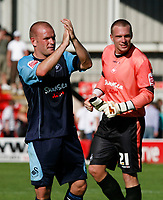 Photo: Steve Bond.<br />Walsall v Swansea City. Coca Cola League 1. 25/08/2007. Andy Robinson & Dorus De Vries at the end of the game