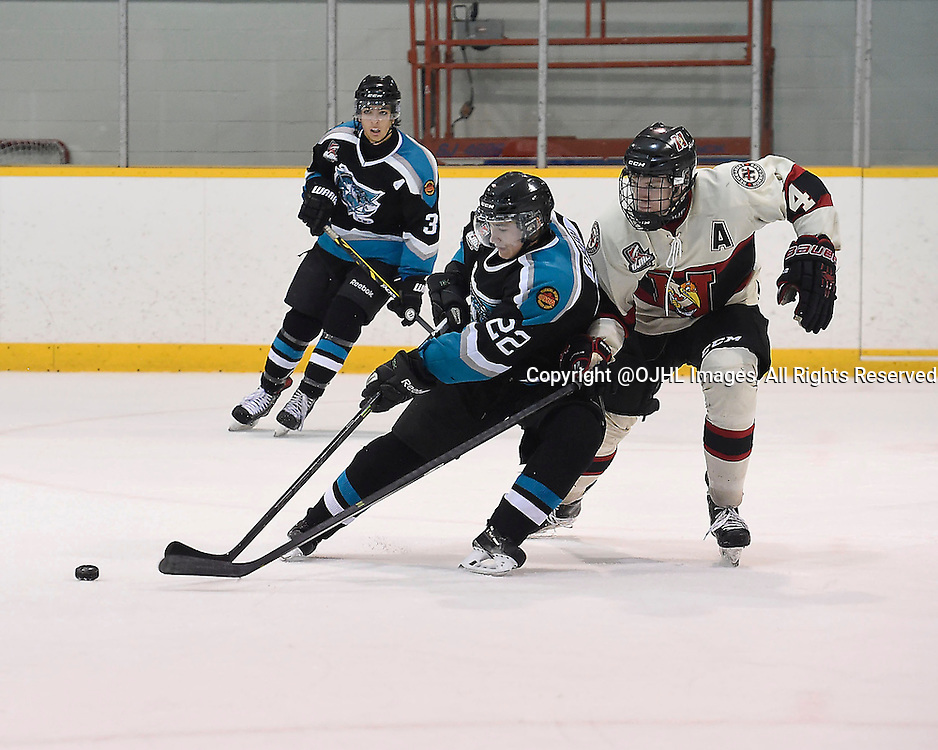 LINDSAY, ON - Sep 18, 2015 : Ontario Junior Hockey League game action between Newmarket and Lindsay, Cedric Ralph #22 of the Lindsay Muskies battles to control the puck with Adam Smith #4 of the Newmarket Hurricanes during the second overtime period.<br /> (Photo by Andy Corneau / OJHL Images)