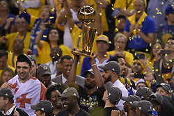June 12, 2017 - Oakland, CA, USA - The Golden State Warriors' Kevin Durant holds the championship trophy after defeating the Cleveland Cavaliers, 129-120, in Game 5 of the NBA Finals at Oracle Arena in Oakland, Calif., on Monday, June 12, 2017. (Credit Image: © Jose Carlos Fajardo/TNS via ZUMA Wire)