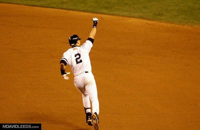 01 November 2001 Bronx, NY:  New York Yankees shortstop Derek Jeter celebrates as he rounds first base after hitting a walkoff home run against the Arizona Diamondbacks in Game 4 of the World Series.<br /> MANDATORY CREDIT: Photo by M David Leeds