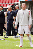 Photo: Chris Ratcliffe.<br />England Training Session. FIFA World Cup 2006. 19/06/2006.<br />Wayne Rooney in the foregound and Sven Goran Eriksson in training.