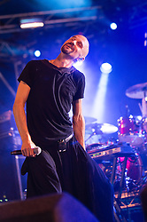 © Licensed to London News Pictures. 20/07/2014. Southwold, UK.   James performing live at Latitude Festival 2014 on Day 3. The band were originally scheduled to play yesterday but missed their flight so were rescheduled to play today instead.  In this picture - Tim Booth.  The Latitude Festival is a British annual music festival.  Photo credit : Richard Isaac/LNP