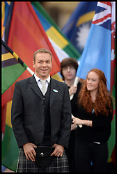 Queen's Baton Relay Launch at Buckingham Palace.<br /> Sir Chris Hoy with the Commonwealth flags after the Baton Relay Launch. The QBR Launch is an exceptionally high-profile Games event, an important milestone that begins the QBR that will unite the Commonwealth, at Buckingham Palace, London, United Kingdom. Wednesday, 9th October 2013. Picture by Andrew Parsons / i-Images