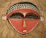 Buffalo Mask from Pendle culture of Democratic Republic of the Congo (Zaire). Early 20th Century. Wood and raffia. Used at boys' initiation ceremonies. Red shows the seniority of age over youth