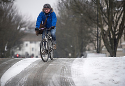 © Licensed to London News Pictures. 01/03/2018. London, UK. A cyclist navigates an icy road in Little Venice, North London as the capital continues to be hit by extreme winter conditions. Large parts of the UK are experiencing disruption as freezing temperatures continue. Photo credit: Ben Cawthra/LNP