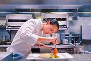 Executive Chef Paula DaSilva prepares presentation of olive oil poached swordfish at the now-closed reatuarant 1500 Degres in Miami Beach's Eden Roc hotel