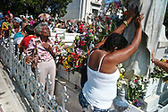 Cubans praying to Amelia the miracle virgin, at Havana´s cemetery during mothers day