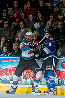 KELOWNA, CANADA - MARCH 11: Devante Stephens #21 of the Kelowna Rockets checks Jack Walker #9 of the Victoria Royals during second period on March 11, 2017 at Prospera Place in Kelowna, British Columbia, Canada.  (Photo by Marissa Baecker/Shoot the Breeze)  *** Local Caption ***