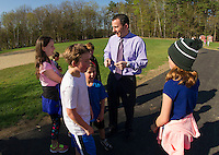 Principal Dave Levesque with students on the new walking path dedicated on Wednesday morning at Pleasant Street School.  (Karen Bobotas/for the Laconia Daily Sun)