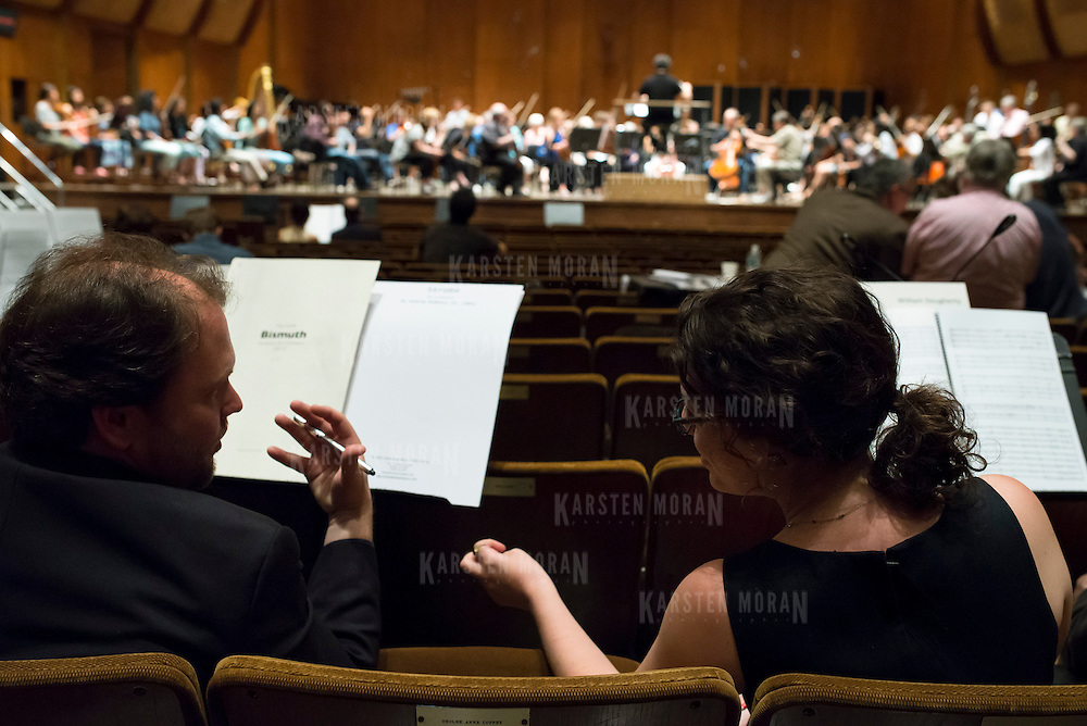 June 3, 2014 - New York, NY : Composers Jesse Jones, foreground left, and Julia Adolphe, foreground right, interact during a rehearsal of one of their colleagues' works by the New York Philharmonic at Avery Fisher Hall on Tuesday. Three works by little-known composers, such as Jones and Adolphe, will be selected for inclusion in the New York Philharmonic's Biennial. CREDIT: Karsten Moran for The New York Times