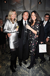 Left to right, AMANDA WAKELEY, RICHARD CARING and LUCY RUSEDSKI at a dinner hosted by Ruinart in honour of Amanda Wakely at The Connaught, Carlos Place, London on 20th October 2010.