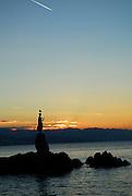 Statue of Lady with Seagull at sunrise. Opatija, Croatia