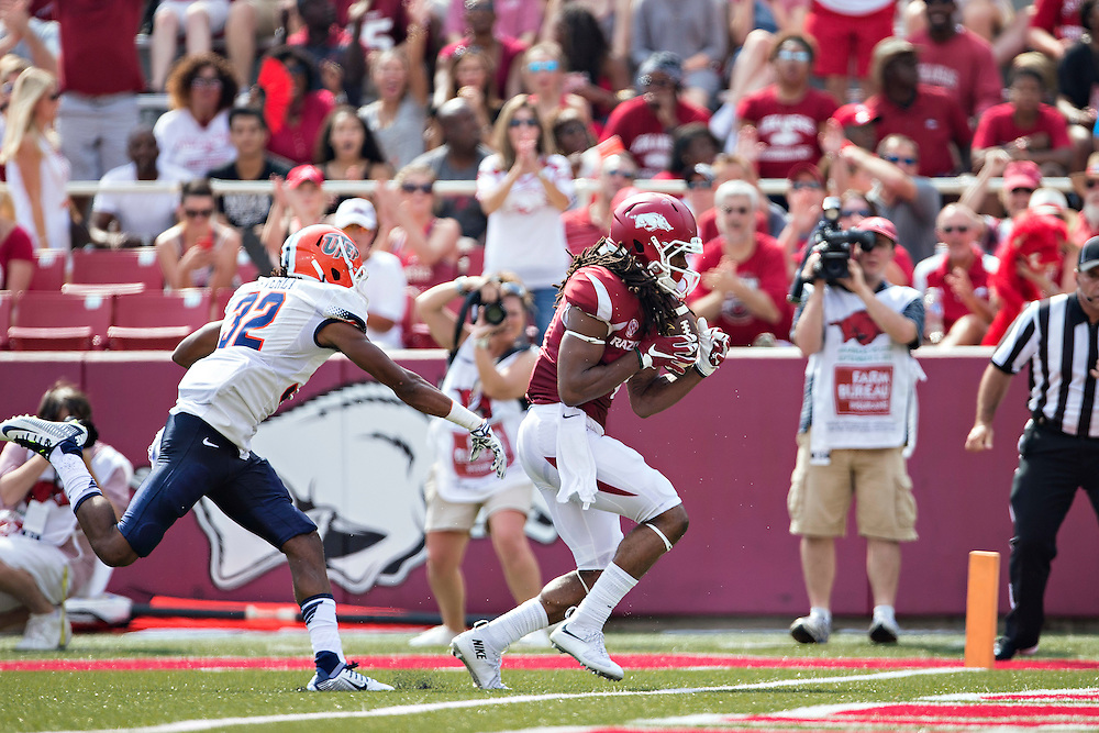 FAYETTEVILLE, AR - SEPTEMBER 5:  Keon Hatcher #4 of the Arkansas Razorbacks catches a touchdown pass over Kalon Beverly #32 of the UTEP Miners at Razorback Stadium on September 5, 2015 in Fayetteville, Arkansas.  The Razorbacks defeated the Miners 48-13.  (Photo by Wesley Hitt/Getty Images) *** Local Caption *** Keon Hatcher; Kalon Beverly