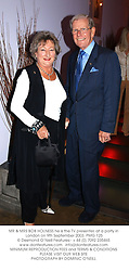 MR & MRS BOB HOLNESS he is the TV presenter, at a party in London on 9th September 2003.PMG 125