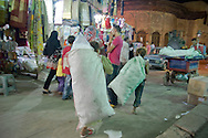 It is common to see zabaleen children collecting packaging stores in the market of Khan El-Khalili.