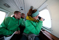 NORWAY BARENTS SEA 6DEC15 - Greenpeace campaigners Larissa Baeumer, Christian Bussau of Germany and Erlend Tellnes (L) of Norway search for the production platform Goliat in the Barents Sea operated by Italian energy compay Eni. It is the world's most northerly oil production platform.<br /> <br /> jre/Photo by Jiri Rezac / Greenpeace<br /> <br /> © Jiri Rezac 2015