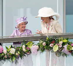 © Licensed to London News Pictures. 07/06/2014. Epsom, UK. HRH Queen Elizabeth II watches the Derby from the balcony of the grandstand whilst talking to Princess Michael of Kent . Derby Day today 7th June 2014 at Epsom 2014 Investic Derby Festival in Surrey. Traditionally, elegant, fashionable racegoers gather for a classic day's racing at Epsom Racecourse, Surrey. Photo credit : Stephen Simpson/LNP