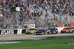 February 24, 2019 - Hampton, GA, U.S. - HAMPTON, GA - FEBRUARY 24: Aric Almirola, Stewart-Haas Racing, Ford Mustang Smithfield (10) leads the field of cars to the green flag to start the 60th annual running of the Folds of Honor Quik Trip 500 Monster Energy NASCAR Cup Series race on February 24, 2019 at the Atlanta Motor Speedway in Hampton, GA.  (Photo by David J. Griffin/Icon Sportswire) (Credit Image: © David J. Griffin/Icon SMI via ZUMA Press)